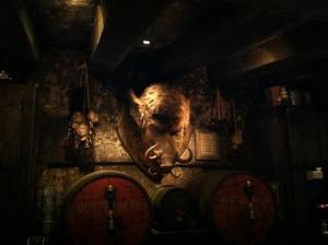 This hog's head sits above the bar at the Hog's Head. Below are tankards of yummy butterbeer.
